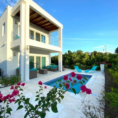 The pool patio and outdoor area at Gracehaven Villa Providenciales, Turks and Caicos